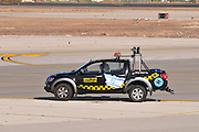 Israel, Ben-Gurion international Airport The follow me car guiding planes into their parking bay