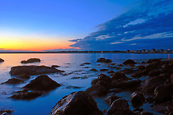 The after glow of a red sunset warms the blue twilight overcoming Horseneck Beach, Massachusetts.