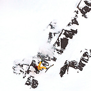 Freeskier Ted Davenport of the United States crashes and breaks a ski on his first run after launching off a drop during  the World Heli Challenge Extreme Day at Mount Albert on Minaret Station, Wanaka, New Zealand. Davenport, the two time defending champion pushed himself to the limit on his second run and  tragically broke both legs landing on hard rock just below the surface of the snow. His injures included a broken tibia and fibula. Emergency services reached Davenport who was air lifted to Wanaka Lake Health Centre then on to Dunedin hospital for surgery. He is due to marry in a few weeks time. 1st August 2011. Photo Tim Clayton.