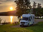 Golden sunset over Pleasure-Way Plateau XLTS RV, at Mcleese Lake Resort, 6721 Cariboo Hwy 97 N, McLeese Lake, British Columbia V0L 1P0, Canada.