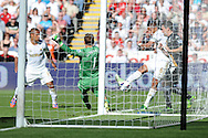 Fulham keeper Mark Schwarzer blocks a shot from Swansea's Ashley Williams (6) from a tight angle. Barclays Premier league, Swansea city v Fulham at the Liberty Stadium in Swansea, South Wales on Sunday 19th May 2013. pic by Andrew Orchard,  Andrew Orchard sports photography,