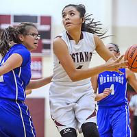 Ramah Mustang Cauy DuBoise (4) dodges Navajo Pine Warrior Cheynay Castillo (22) Tuesday at Ramah High School.