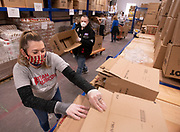 JOINT BASE CAPE COD - Catherine Sutton, strike team leader for disaster response NGO, Team Rubicon, put together boxes that will contain a 14-day supply of food for veterans and their families on Thursday, April 2, 2020. This Food4Vets is organized by the Massachusetts and Cape Cod Military Support Foundations and has a goal of distributing 50,000 boxes.