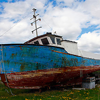North America, Canada, Nova Scotia, Eastern Shore. Grounded fishing boat at Sheet Harbour.