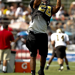 August 1, 2010; Metairie, LA, USA; New Orleans Saints safety Usama Young (28) catches the ball during a training camp practice at the New Orleans Saints practice facility. Mandatory Credit: Derick E. Hingle