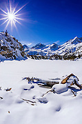 Long Lake and Sierra Peaks in winter, John Muir Wilderness, Sierra Nevada Mountains, California  USA
