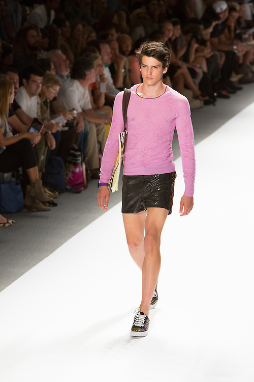 Shiny black men's shorts with a long-sleeve pink lace top. By Custo Barcelona at the Spring 2013 Fashion Week show in New York.