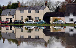 © Licensed to London News Pictures. 26/11/2012. Oxfordshire, UK Oxfordshire cottages in Binsey reflected in a flooded field. Flooding on the River Thames today 26th November 2012 in Oxfordshire. Photo credit : Stephen Simpson/LNP
