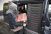 """Cherry tomatoes. Sandrine Ruiz loading donations of unsold food that would most likely be discarded, from the Paris Rungis vegetable market<br /><br />The Freegan Pony is an alternative restaurant housed in a squat. It was founded in 2015 by Aladdin Charni with three other collaborators. The restaurant specialises in cheap vegetarian cuisine, serving meals which guests reserve a place through a Facebook group, paying €2 a meal. The restaurant meals contain unsold and donated food, collected from wholesellers at the Paris Rungis vegetable market. The Freegan Pony is located at the Porte de la Vilette on the outskirts of Paris, at the entrance to the peripherique outer circle motorway.<br /><br />Freegans are people who employ alternative strategies for living based on limited participation in the conventional economy and minimal consumption of resources. Freeganism is the practice of reclaiming and eating food that has been discarded. People who attempt to live an ethical lifestyle by reusing trash and rubbish thrown away by others.<br /><br />Freeganism is an ill-defined activity and is a subset of the larger anti-capitalist and environmental protest movements. It embraces alternative, anti-consumerist lifestyles. Freegan practices also include co-operative living, squatting and """"freecyling"""", or matching things that people want to get rid of with things other people need"""