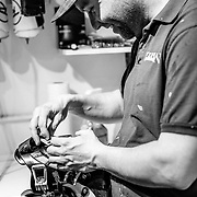 Tanner Flanagan works on his ski boots inside of Teton Boot Lab.