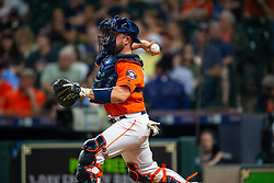 April 13, 2018 - Houston, TX, U.S. - HOUSTON, TX - APRIL 13: Houston Astros catcher Max Stassi (12) throws a warmup to second base in the ninth inning during an MLB game between the Houston Astros and the Texas Rangers and April 13, 2018 at Minute Maid Park in Houston, TX.  (Photo by Juan DeLeon/Icon Sportswire) (Credit Image: © Juan Deleon/Icon SMI via ZUMA Press)