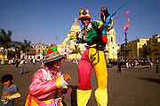 PERU, LIMA, COLONIAL Plaza de Armas; street entertainers