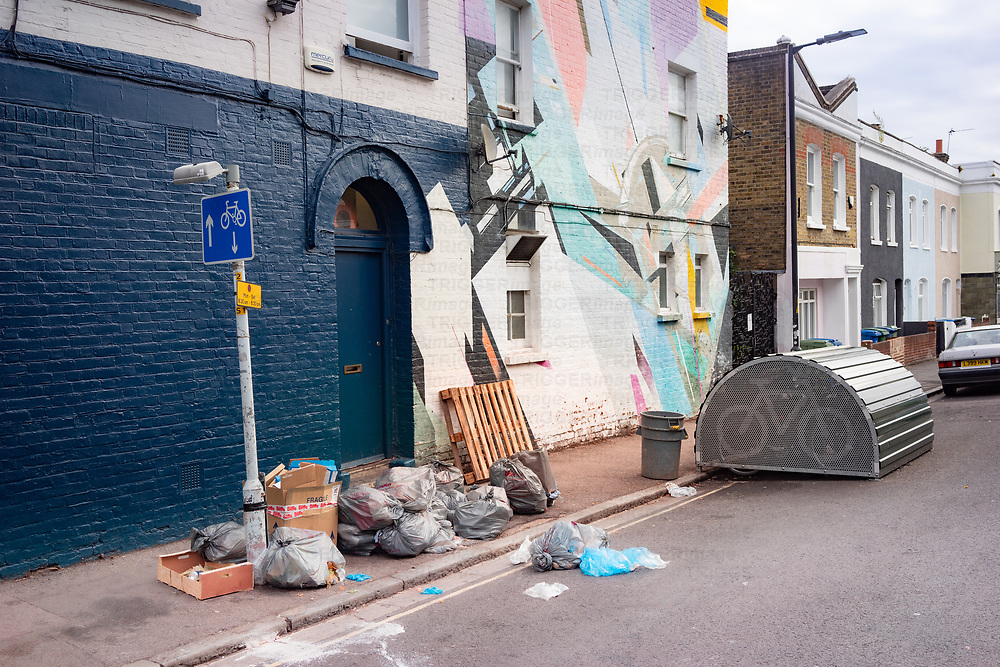 mural street painting and rubbish on the street in Dulwich south London
