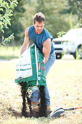 Man preparing a hole with dirt for a tree planting