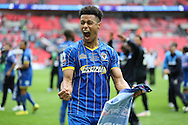 Lyle Taylor of AFC Wimbledon celebrates after winning the match. Skybet football league two play off final match, AFC Wimbledon v Plymouth Argyle at Wembley Stadium in London on Monday 30th May 2016.<br /> pic by John Patrick Fletcher, Andrew Orchard sports photography.