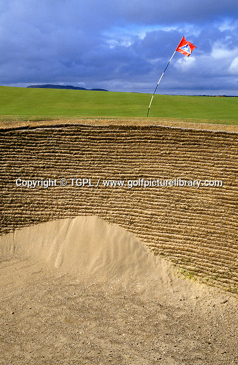 11th par 3 (circa 1996) showing a very windy day with the riveted bunker with sand blown up the face at ST.ANDREWS Old Course,St.Andrews,Fife,Scotland.