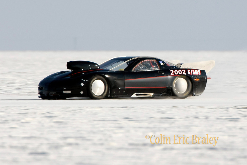 """Best cars-people-atmosphere-photos of 2009 Bonneville Speed Week-  Roland """"Sandy"""" Percey, owner and driver of the 2002 Chevy Corvette, from Altadena, CA. makes a run at the Bonneville Speed Way. August 9, 2009.  Photo by Colin E. Braley"""