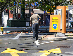 © Licensed to London News Pictures. 01/06/2020. London, UK. A staff member cleans the drive-thru with a power jet as Mcdonald's in Haringey, north London, prepares to re-open later this week after lockdown restrictions are eased in England after ten weeks. Photo credit: Dinendra Haria/LNP