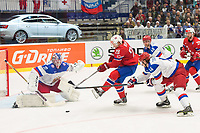Ishockey<br /> VM 2015<br /> Russland v Norge 6:2<br /> 01.05.2015<br /> Foto: imago/Digitalsport<br /> NORWAY ONLY<br /> <br /> Niklas Røst (NOR) shoots on Goalie Sergei Bobrovski (RUS) and getting checked by Viktor Tikhonov (RUS).