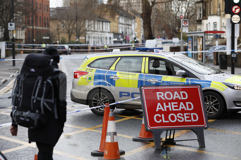 © Licensed to London News Pictures. 22/01/2018. London, UK. The scene in Romford Road after a shooting incident. Roads are closed after a man was shot in the head. Photo credit: Peter Macdiarmid/LNP