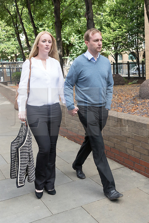 © Licensed to London News Pictures. 29/07/2015. London, UK. Former trader, TOM HAYES and his wife, Sarah arrive at Southwark Crown Court in London. Hayes appears charged with eight counts of conspiracy to defraud in relation to alleged manipulation and rigging of the global Libor interest rate. The jury has retired to consider its verdict. Photo credit : Vickie Flores/LNP