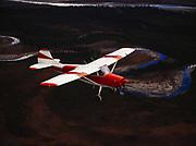 Rick Schikora flying his Cessna 170 above the North Fork of the Koyukuk River northeast of Bettles, Alaska.