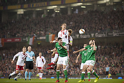 November 14, 2017 - Dublin, Ireland - Yussuf Poulsen of Denmark jumps for the ball with Stephen Ward of Ireland during the FIFA World Cup 2018 Play-Off match between Republic of Ireland and Denmark at Aviva Stadium in Dublin, Ireland on November 14, 2017 Denmark defeats Ireland 5:1. (Credit Image: © Andrew Surma/NurPhoto via ZUMA Press)
