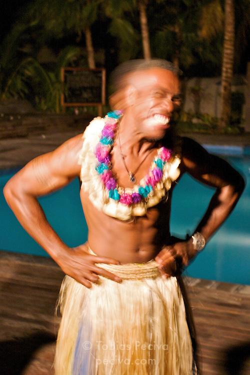 Local Fijian man performing a dance at Octopus Resort on Waya Island. Waya is part of the Yasawa Islands, on the western side of Fiji.
