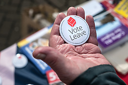 A badge supporting the UK exit from the European Union held in a hand. March 2016