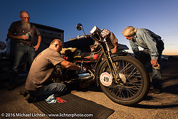 Mark Hill works with his crew to get Frank Westfall's 4th cylinder in his 4-cylinder 1912 Henderson class-2 bike in Lake Havasu, Arizona during the Motorcycle Cannonball Race of the Century. Stage-13 ride from Williams, AZ to Lake Havasu City, AZ. USA. Friday September 23, 2016. Photography ©2016 Michael Lichter.