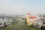 Korail slum, just opposite one of the richest areas of Dhaka. The capital now officially counts more than 18 million inhabitants. It is predicted to grow to 36 million by 2050, many of whom will be relocating because of climate change.