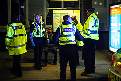 © Licensed to London News Pictures. 13/04/2021. Manchester, UK. Police are seen detaining one of two men for unknown reasons , outside Chorlton Street coach station . People on a night out in Manchester City Centre as government restrictions to control the spread of Coronavirus are eased across the UK. Pubs, restaurants, hairdressers, gyms and non essential retailers are now permitted to serve customers within restrictions. Photo credit: Joel Goodman/LNP