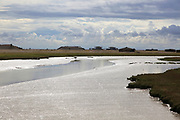 Orford Ness lighthouse Open Day, September 2017, Suffolk, England, UK - Stony Ditch drainage ditch low tide military research pagodas
