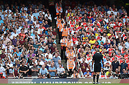 West Ham United fans & Arsenal fans look on divided by a line of stewards. Barclays Premier League, Arsenal v West Ham Utd at the Emirates Stadium in London on Sunday 9th August 2015.<br /> pic by John Patrick Fletcher, Andrew Orchard sports photography.