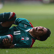 Javie Aquino, Mexico, in pain after a tackle during the Brazil V Mexico Gold Medal Men's Football match at Wembley Stadium during the London 2012 Olympic games. London, UK. 11th August 2012. Photo Tim Clayton
