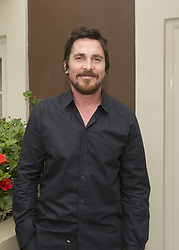 November 16, 2013 - Hollywood, California, U.S. - CHRISTIAN BALE promotes 'Out Of The Furnace' at the Four Seasons Hotel. Christian Charles Philip Bale (born 30 January 1974) is an English actor. He has starred both in blockbuster films and smaller projects from independent producers and art houses. Bale first caught the public eye at the age of 13, when he was cast in the starring role of Empire of the Sun (1987). In 2000, he garnered critical acclaim for his portrayal of serial killer Patrick Bateman in American Psycho. He is known for going to great lengths to portray characters in films, notably for the psychological thriller The Machinist (2004), where he lost 63 pounds (28.5 kg) to play the role of Trevor Reznik. Bale went on to receive greater commercial recognition for his starring role as Batman in Christopher Nolan's Batman Begins (2005), The Dark Knight (2008) and The Dark Knight Rises (2012). His portrayal of Dicky Eklund in The Fighter (2010), earned him critical acclaim and a number of awards, including the Academy Award for Best Supporting Actor. He has since gained further acclaim as well as subsequent Academy Award, Screen Actors Guild Award and Golden Globe nominations for his roles in American Hustle (2013) and Adam McKay's The Big Short (2015). Jungle Book (2018), Hostiles (2017), Untitled Dick Cheney Project (pre-production), The Promise (2016). (Credit Image: © Armando Gallo via ZUMA Studio)
