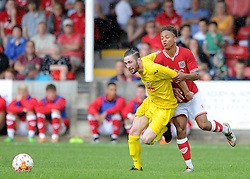 Bobby Reid of Bristol City closes down Brislington's Liam Knight - Photo mandatory by-line: Dougie Allward/JMP - Mobile: 07966 386802 - 05/07/2015 - SPORT - Football - Bristol - Brislington Stadium - Pre-Season Friendly