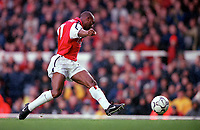 Sylvian Wiltord slips the ball between  Manchester City goalkeeper Nicky Weavers legs for the 3rd Arsenal goal. Arsenal v Manchester City, F.A.Carling Premiership, 28/10/2000. Credit Colorsport / Stuart MacFarlane.