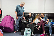 DURANT, OKLAHOMA - MARCH 24:  Larry Long, director of the Durant Boys and Girls Club, visits with students in one of the common rooms at the Boys and Girls Club in Durant, Oklahoma on March 24, 2017. (Photo by Cooper Neill for The Washington Post)