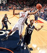 CHARLOTTESVILLE, VA- December 3: Mike Scott #23 of the Virginia Cavaliers grabs a rebound over David Robinson #13 of the Longwood Lancers during the game on December 27, 2011 at the John Paul Jones Arena in Charlottesville, Virginia. Virginia defeated Longwood 86-53. (Photo by Andrew Shurtleff/Getty Images) *** Local Caption *** David Robinson;Mike Scott
