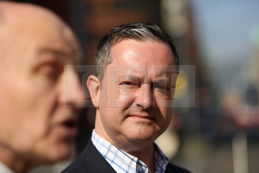 """© Licensed to London News Pictures. 9/05/2016. Belfast, Northern Ireland, UK. Gay rights activist Gareth Lee listens to  Dr Michael Wardlow, Chief Commissioner for the Equality Commission for Northern Ireland, outside the Belfast High Court before the start Appeal hearing over gay marriage cake row with Ashers Baking Company. The legal appeal by Ashers Baking Company in the controversial 'gay cake' case is to be heard over two days. In May last year a judge at Belfast County Court ruled that the bakery had acted unlawfully. The court ordered Ashers to pay £500 damages after Judge Isobel Brownlie said the customer had been treated """"less favourably"""" contrary to the law and the bakery had breached political and sexual orientation discrimination regulations. But the McArthur family who own and run Ashers decided to challenge the ruling following consultations with their legal advisors. The family has been given the full support of The Christian Institute, which has funded their defence costs. The legal case followed a decision in May 2014 by Ashers to decline an order placed at its Belfast store by a gay rights activist who asked for a cake featuring the Sesame Street puppets, Bert and Ernie, and the campaign slogan, 'Support Gay Marriage'. The customer also wanted the cake to feature the logo of a Belfast-based campaign group QueerSpace. Ashers, owned by Colin and Karen McArthur, refused to make the cake because it carried a message contrary to the family's firmly-held Christian beliefs. They were supported by their son Daniel, the General Manager of the company. But the Equality Commission for Northern Ireland (ECNI) launched a civil action against the family-run bakery, claiming its actions violated equality laws in Northern Ireland and alleging discrimination under two anti-discrimination statutes – The Equality Act (Sexual Orientation) Regulations (NI) 2006 and The Fair Employment and Treatment (NI) Order 1998. Photo credit : Paul McErlane/LNP"""