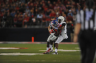 Mississippi Rebels wide receiver Laquon Treadwell (1) is tackled by Vanderbilt Commodores cornerback Torren McGaster (5) at Vaught-Hemingway Stadium at Ole Miss in Oxford, Miss. on Saturday, September 26, 2015. (AP Photo/Oxford Eagle, Bruce Newman)