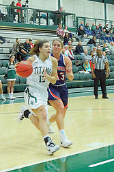 06 December 2017:  Sydney Shanks defended by Jennifer Berg on the baseline during an NCAA women's basketball game between the Wheaton Thunder and the Illinois Wesleyan Titans in Shirk Center, Bloomington IL