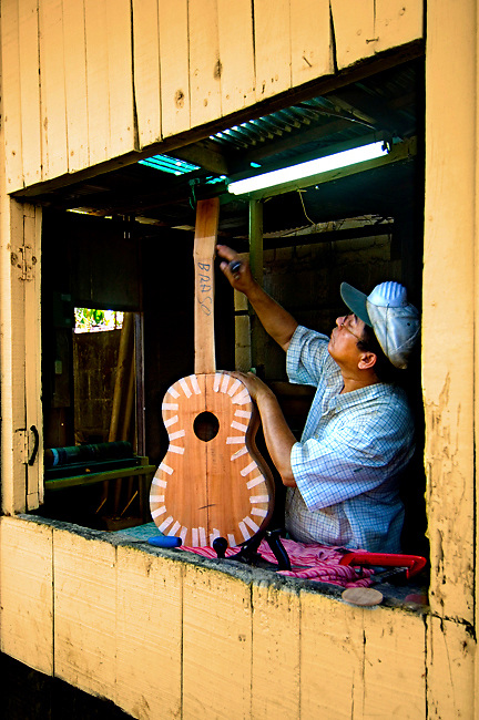 Guitar maker crafts a guitar at Guitarros Zepeda, a guitar<br /> workshop for three generations in Masaya, Nicaragua.
