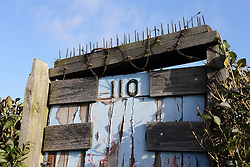 Allotment gate 110 with spikes on top.