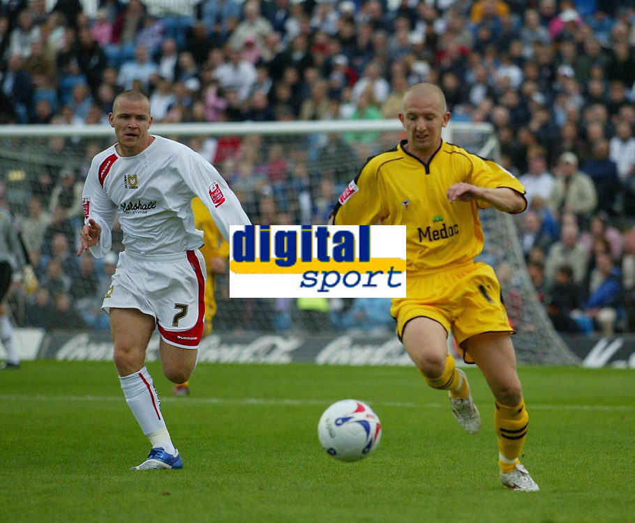 Photo: Marc Atkins.<br /> <br /> Milton Keynes Dons v Notts County. Coca Cola League 2. 02/09/2006. Notts County's Andy Parkinson (R) is chased by MK Dons Jon Paul McGovern.