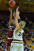 March 18, 2016; Tempe, Ariz;  New Mexico State Aggies guard Tamera William (21) shoots over Arizona State Sun Devils forward Kelsey Moos (24) during a game between No. 2 Arizona State Sun Devils and No. 15 New Mexico State Aggies in the first round of the 2016 NCAA Division I Women's Basketball Championship in Tempe, Ariz. The Sun Devils defeated the Aggies 74-52.