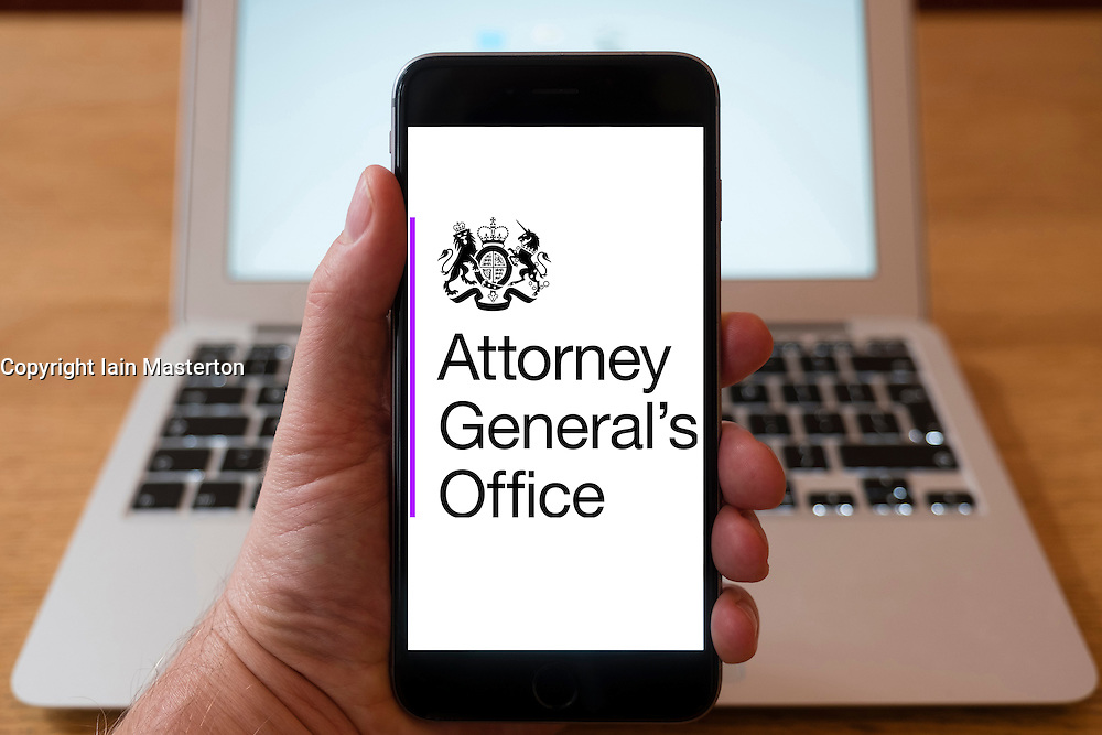 Using iPhone smartphone to display logo of Attorney General's Office, UK Government.