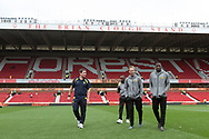 Burton Albion manager Nigel Clough with players (L-R) Burton Albion midfielder Lloyd Dyer (11), Burton Albion striker Luke Varney (16) and Burton Albion striker Lucas Akins (10) before the EFL Sky Bet Championship match between Nottingham Forest and Burton Albion at the City Ground, Nottingham, England on 21 October 2017. Photo by Richard Holmes.