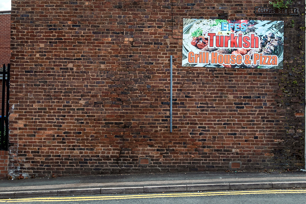 Advert for Turkish grill house and Pizza on a brick wall, Tipton, northwest of Birmingham, West Midlands, UK